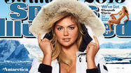 Kate Upton looks [blank] on the cover of the 2013 Sports Illustrated swimsuit issue.