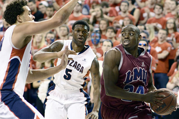Loyola Marymount's Ayodeji Egbeyemi drives as Gonzaga's Elias Harris and Gary Bell Jr. defend during Saturday's game.