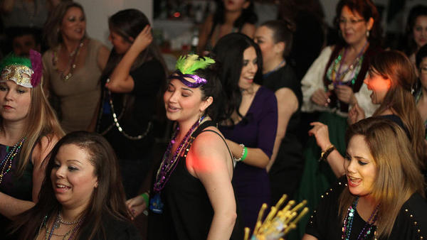 Revelers dance the night away during the annual Mardi Gras celebration in Calexico on Friday.