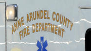 Anne Arundel County Fire Department officials say a shuttle bus at BWI Thurgood Marshall Airport overturned Sunday morning, injuring three people and temporarily interrupting light rail service in that area.