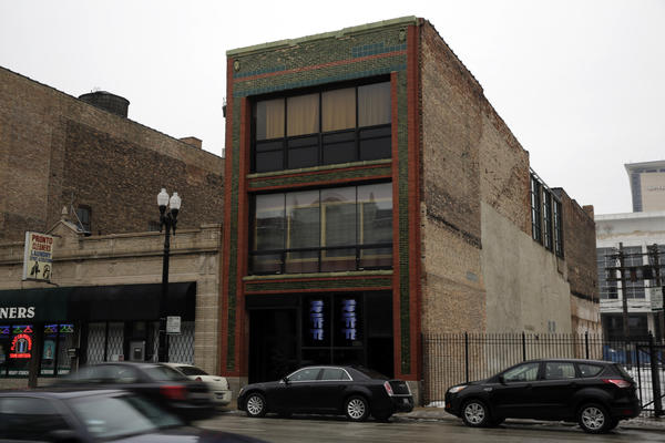 The scene outside a nightclub located on the second floor at 2239 S. Michigan Ave. (building on right) on Sunday. The building was closed early Sunday morning, due to overcrowding at a Saturday night party.