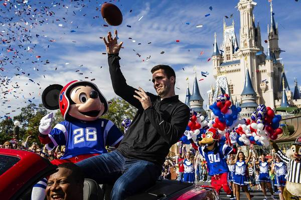 Baltimore Ravens quarterback and Super Bowl XLVII Most Valuable Player Joe Flacco rides with Mickey Mouse last week during a parade through the Magic Kingdom at Disney World. February, 4, 2013. REUTERS/Matt Stroshane/Walt Disney World/Handout (UNITED STATES - Tags: SPORT FOOTBALL ENTERTAINMENT TRAVEL) NO SALES. NO ARCHIVES. FOR EDITORIAL USE ONLY. NOT FOR SALE FOR MARKETING OR ADVERTISING CAMPAIGNS. THIS IMAGE HAS BEEN SUPPLIED BY A THIRD PARTY. IT IS DISTRIBUTED, EXACTLY AS RECEIVED BY REUTERS, AS A SERVICE TO CLIENTS ORG XMIT: TOR401
