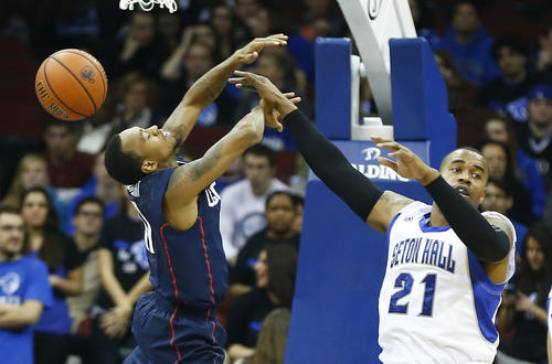Seton Hall Pirates center Eugene Teague (21) fouls Connecticut Huskies guard Ryan Boatright (11) as he drives to the basket during the second half at the Prudential Center.