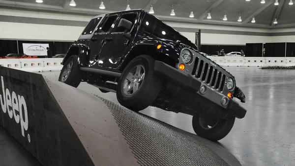 The Jeep folks offered auto show goers a run on their obstacle course, including this 30 degree banked ramp.