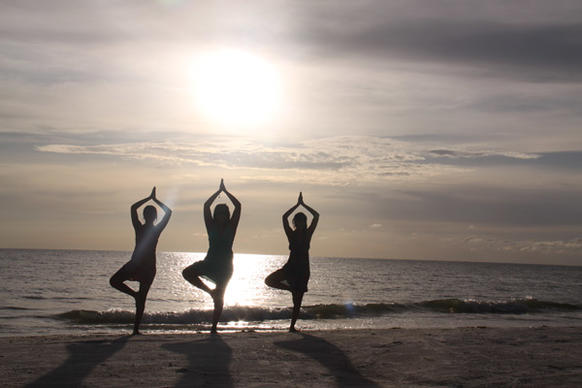"Sunset on the beach at Fort De Soto Park — the perfect time for Neha Hebbar, Anisha Mohandas and Nidhi Hebbar to practice yoga. The young women were visiting the park south of St. Pete Beach to relax and enjoy the natural pleasures of the peaceful area when Velluva Mohandas, Anisha's mother, captured their striking poses. Fort De Soto Park was named America's top beach in 2008 and 2009 by TripAdvisor, which cited its ""spectacular combination of soft white sand, calm, clear water and a laid-back atmosphere."" The park includes amenities such as fishing piers, docks, a camping area and recreation trails on land and in the water."