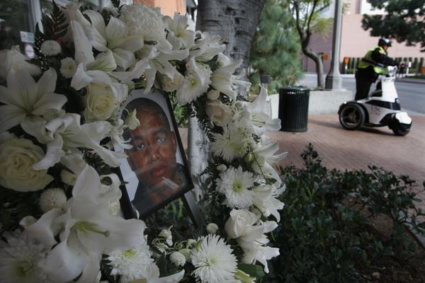 A memorial for USC Public Safety Officer Keith Lawrence is set up outside the Department of Public Safety on the USC campus Sunday.