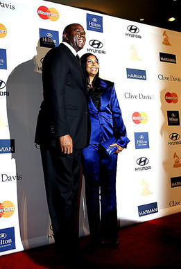 Magic Johnson with wife Cookie pose on the red carpet.