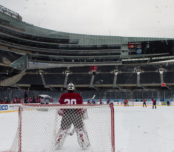 The Latin Romans and the St. Ignatius Wolfpack kick off High School Hockey Faceoff as part of the 2013 Hockey City Classic Winter Festival held at Soldier field on Friday, February 8, 2013.