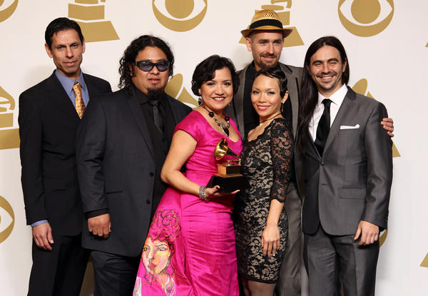 "Musical group Quetzal poses backstage with its award for Latin rock, urban or alternative album for ""Imaginaries"" at the 55th Grammy Awards."