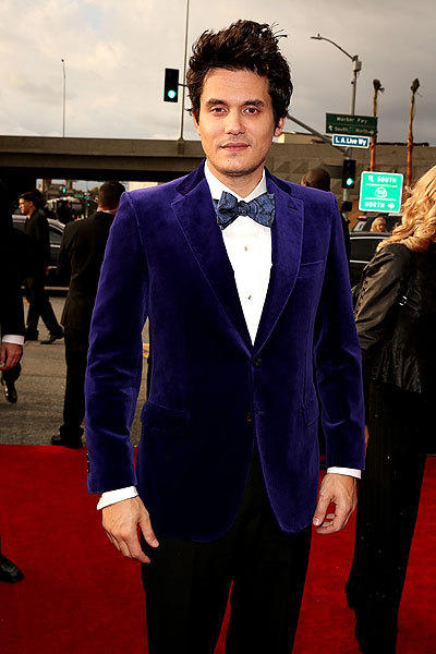 John Mayer accessorizes his suit with a flair in his hair at the 55th Grammy Awards in Los Angeles.
