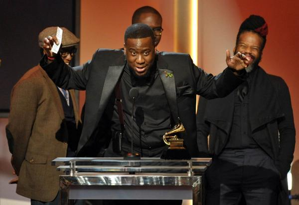 "Recording artist Robert Glasper, center, accepts the award for best R&B album for ""Black Radio."""