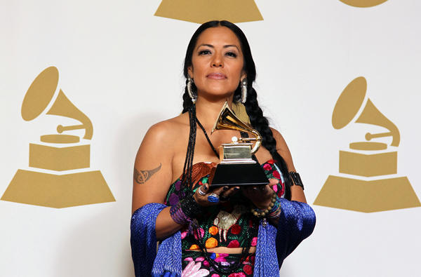"Lila Downs poses backstage with the award for regional Mexican music album (including Tejano) for the album ""Pecados Y Milagros"" at the 55th Grammy Awards."