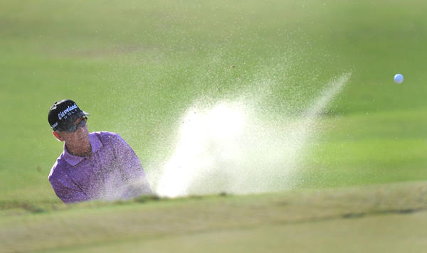 Larry Mize blasts out of a bunker on the 17th hole during the final round of Allianz Championship, a Champions Tour event in Boca Raton, Florida. 2/10/13.