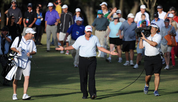Rocco Mediate reacts to his second shot on the 18th hole that bounced off the seating behind the green. The final round of Allianz Championship, a Champions Tour event in Boca Raton, Florida. 2/10/13.