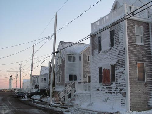 Homes in Scituate, Mass., are crusted with snow and ice.