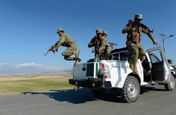 Afghan Local Police jump from their vehicle during a basic police training course in Nangarhar province.
