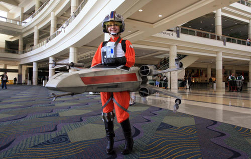 """Nicole Veloskey, 11, of San Diego CA, shows off her """"X-Wing Girl"""" costume."""