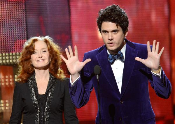 Bonnie Raitt and John Mayer share the stage. Raitt won her 10th Grammy earlier during the pre-telecast show.