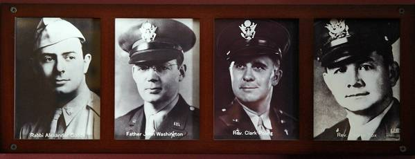 Photos of the four chaplains — from left, Rabbi Alexander Goode, Catholic priest John Washington, Dutch Reformed minister Clark Poling and Methodist minister George Fox — are displayed at the Immortal Chaplains Memorial Sanctuary aboard the Queen Mary in Long Beach.
