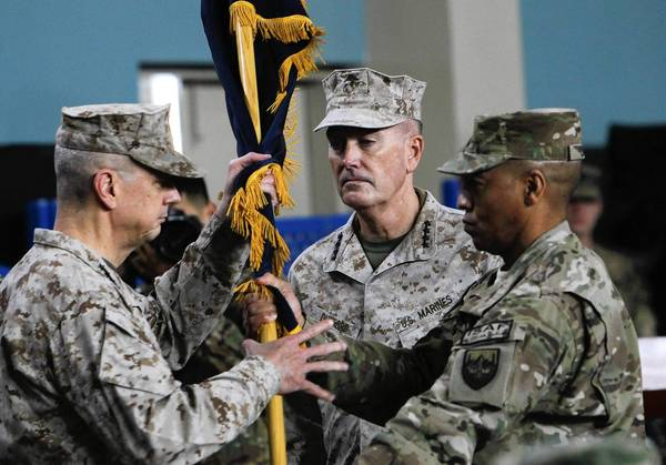 Gen. John R. Allen, left, hands a flag to Gen. Joseph F. Dunford Jr. during a ceremony in Kabul, at which Dunford took over command of the U.S.-led NATO force in Afghanistan.