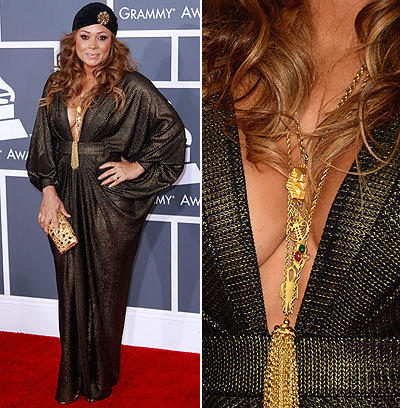 At the 55th Grammy Awards, singer Tamia wears heavy gold jewelry that accentuates her plunging neckline.