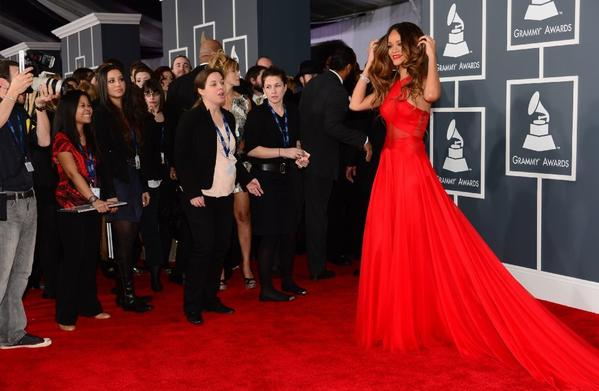 Rihanna draws attention in an elegant gown at the 55th Grammy Awards on Sunday.
