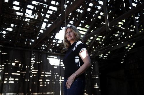 Mary Adams Urashima stands in the barn on the old property of the late Charles Furuta in the area of Huntington Beach once known as Wintersburg. The ex-journalist is trying to preserve the worn buildings of the former prewar Japanese settlement.