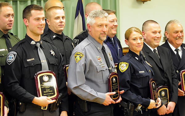 Some of the 16 recipients of awards for excellence and professionalism are shown at the conclusion of the 19th annual Law & Safety Day awards ceremony Sunday at Elks Lodge 778 in Martinsburg, W.Va.