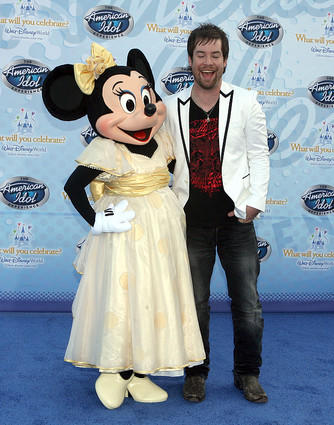 American  Idol season 7 winner David Cook poses with Minnie Mouse at the premiere of The  American  Idol  Experience at Disney's Hollywood Studios on Thursday, February 12, 2009.