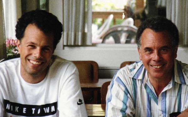 Michael Fosberg — shown with his father, John Sydney Woods, in Virginia Beach, Va., circa 1994 — grew up believing he was white. The Chicago man learned of his biracial heritage after searching for Woods.