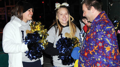 Donny and Laura Penrod stop to get some encouragement from cheerleaders at the Pennsylvania Special Olympics Winter Games on their parade to Central Park in Johnstown for the opening ceremonies.