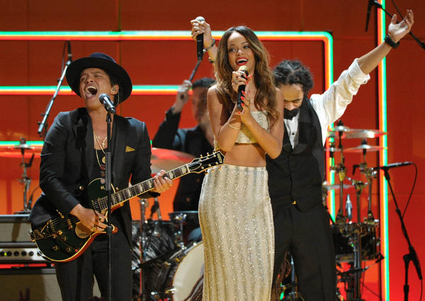 Bruno Mars, left, Rihanna and Damien Marley perform during the Bob Marley tribute at the 2013 Grammy Awards.