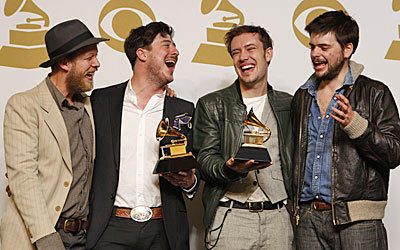 Mumford & Sons backstage at the 55th Annual Grammy Awards.