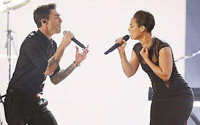 Adam Levine and Alicia Keys sing together at the 55th Annual Grammy Awards.