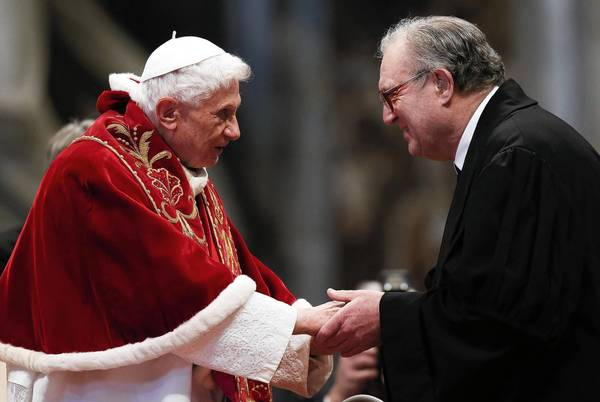 Pope Benedict XVI is greeted by Matthew Festing, Grand Master of the Knights of Malta, during a mass, conducted by Cardinal Tarcisio Bertone, for the 900th anniversary of the Order of the Knights of Malta at the St. Peter Basilica in Vatican