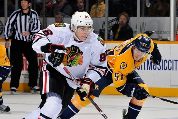 Patrick Kane is pursued by Gabriel Bourque of the Nashville Predators during Sunday's 3-0 victory.