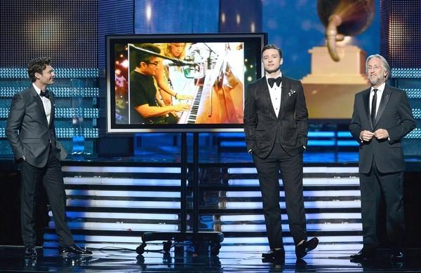 Ryan Seacrest, left, Justin Timberlake and Recording Academy President Neil Portnow speak onstage during the Grammys.