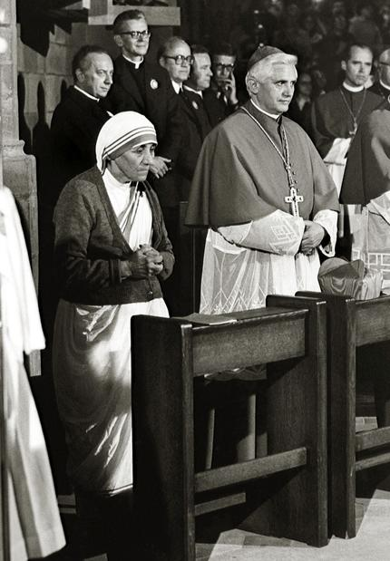 In this September 1978 file photo provided by the German Catholic News Agency (KNA), Albanian-born Mother Teresa and Cardinal Joseph Ratzinger attend a Mass during the 85th German Catholics Day in Freiburg, southern Germany.