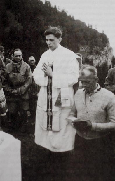 A 1952 photo provided by the German Catholic News Agency (KNA) shows the future Pope Benedict XVI celebrating Mass in the mountains of Ruhpolding, southern Germany.