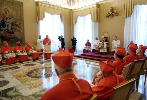 Pope Benedict XVI, seated on the throne, attends a meeting of Vatican cardinals at the Vatican on Monday. The pope announced  that he would resign at the end of the month - the first pontiff to do so in nearly 600 years. The decision sets the stage for a conclave to elect a new pope before the end of March.