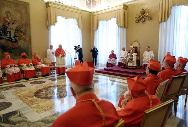 Benedict, seated on throne, attends a meeting of cardinals at the Vatican. His announcement that he would step down set the stage for a conclave to elect a new pontiff before the end of March.