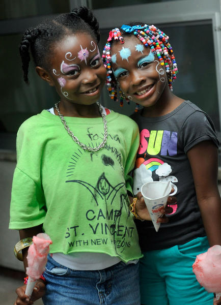 Shekinah Ginyard, left, 6, and Ariel Johnson, 7, enjoy treats during a party on the last day of the year for Camp St. Vincent Friday Aug. 10, 2012 in Baltimore. Camp St. Vincent is a free, eight-week long camp for homeless children. (Photo by Steve Ruark)