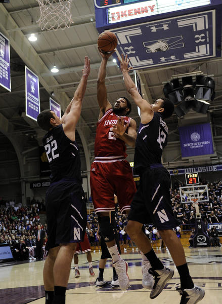 Indiana forward Christian Watford shoots over Northwestern center Alex Olah (left) and forward Jared Swopshire during a Jan. 20 victory over the Wildcats.