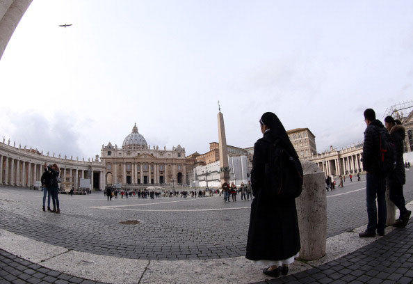 A nun walks in St. Peter's Square on February 11, 2013 in Vatican City, Vatican. Pope Benedict XVI announced that he is to retire on February 28 citing age related health reasons.