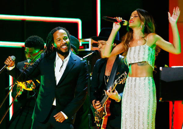 Ziggy Marley (L) and Rihanna perform a tribute to Bob Marley at the 55th annual Grammy Awards in Los Angeles, California, February 10, 2013.