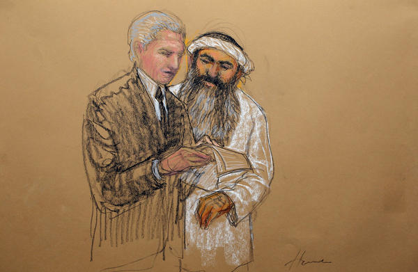 In this courtroom sketch from last year, accused 9/11 mastermind Khalid Shaik Mohammed, right, consults with civilian defense attorney David Nevin in Guantanamo Bay, Cuba.