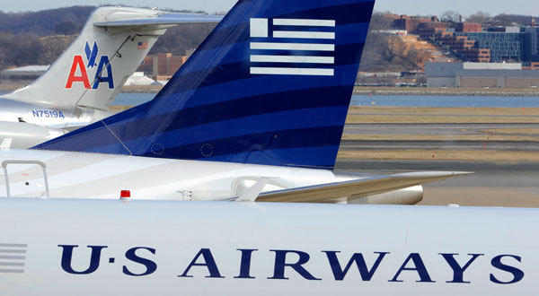 Negotiations continue between parent companies US Airways Group Inc and AMR Corp on a possible $11 billion merger, creating what would be the world's largest airline.