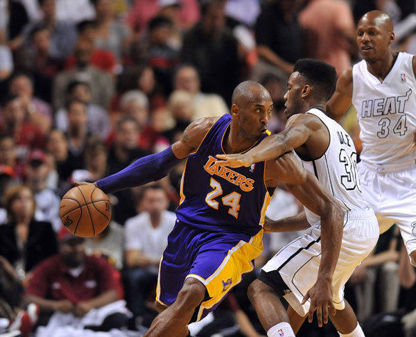 Los Angeles Lakers shooting guard Kobe Bryant (24) is pressured by Miami Heat point guard Norris Cole (30) during the second half at American Airlines Arena. Miami won 107-97.