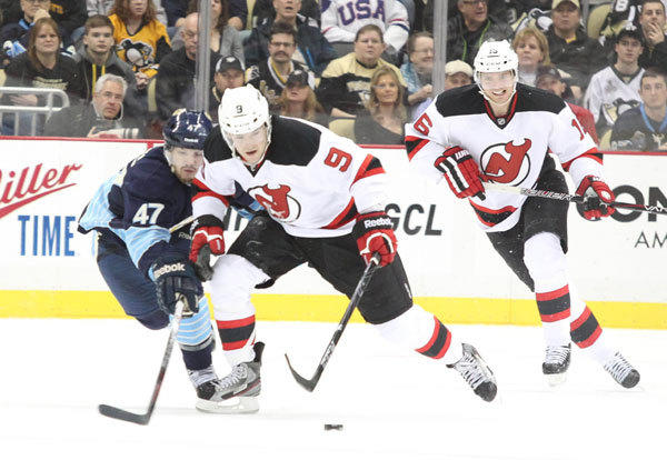 Pittsburgh Penguins defenseman Simon Despres (47) and New Jersey Devils right wing Bobby Butler (9) chase after a lose puck during the third period at the CONSOL Energy Center. The New Jersey Devils won 3-1.