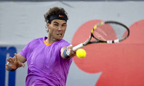 Spanish tennis player Rafael Nadal returns the ball to Argentine Horacio Zeballos at the ATP Vina del Mar tournament final singles match, in Vina del Mar, about 120 km northwest of Santiago, on February 10, 2013.